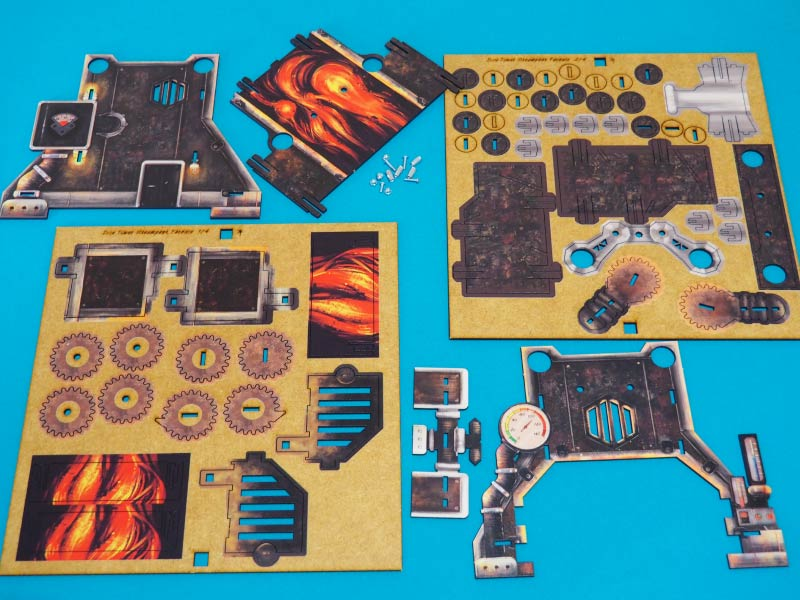 Planchas de HDF y tornillos para montar la torre de dados